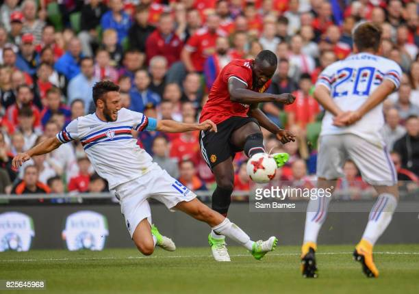 Dublin Ireland 2 August 2017 Romelu Lukaku of Manchester United in action against Vasco Regini left and Daniel Pavolic of Sampdoria during the...