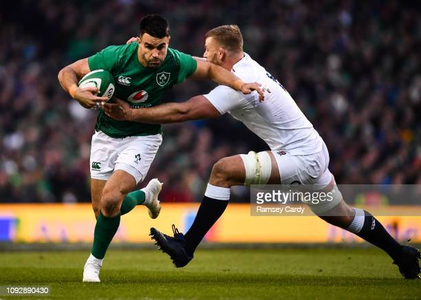 Dublin Ireland 2 February 2019 Conor Murray of Ireland is tackled by George Kruis of England during the Guinness Six Nations Rugby Championship match...