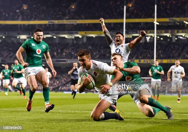 Dublin Ireland 2 February 2019 Henry Slade of England dives over to score his side's third try despite the tackle of Garry Ringrose of Ireland during...