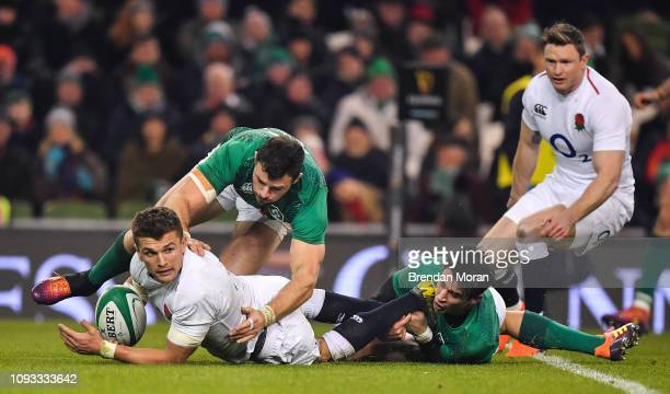 Dublin Ireland 2 February 2019 Henry Slade of England is tackled by /Robbie Henshaw and Joey Carbery of Ireland during the Guinness Six Nations Rugby...