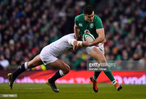 Dublin Ireland 2 February 2019 Jacob Stockdale of Ireland is tackled by Henry Slade of England during the Guinness Six Nations Rugby Championship...
