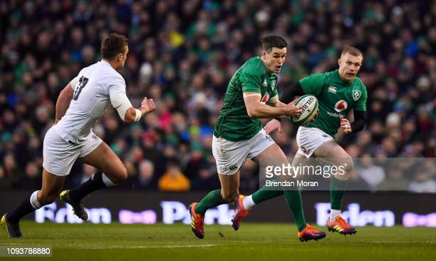 Dublin , Ireland - 2 February 2019; Jonathan Sexton of Ireland breaks away from Henry Slade of England during the Guinness Six Nations Rugby...