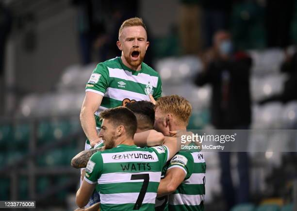 Dublin , Ireland - 2 July 2021; Aaron Greene, hidden, is congratulated by Shamrock Rovers team-mates, including Sean Hoare, after scoring their...