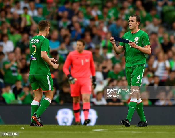 Dublin Ireland 2 June 2018 John O'Shea of Republic of Ireland hands Seamus Coleman the captain's armband before being substituted during the...