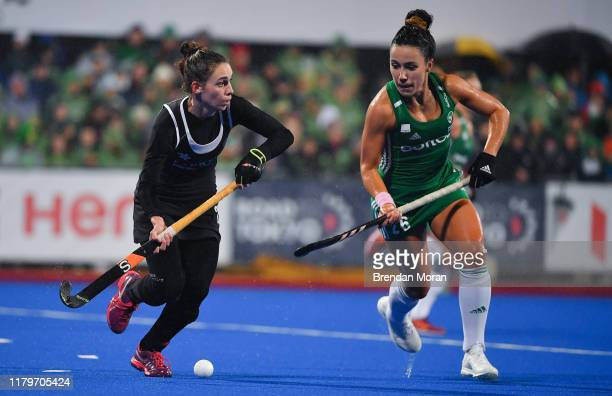 Dublin Ireland 2 November 2019 Amanda Woodcroft of Canada in action against Anna OFlanagan of Ireland during the FIH Women's Olympic Qualifier match...