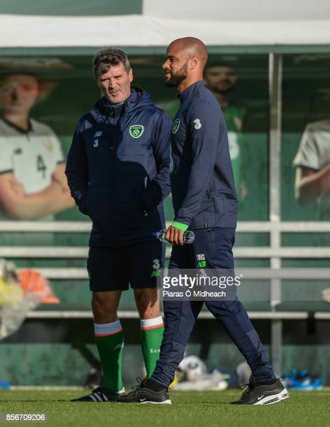 Dublin Ireland 2 October 2017 Republic of Ireland's David McGoldrick with assistant manager Roy Keane during squad training at the FAI National...
