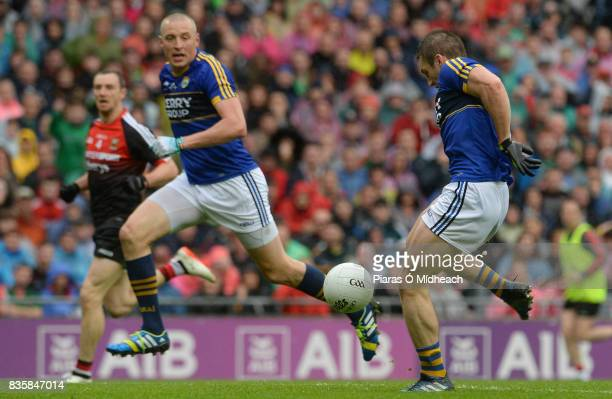 Dublin , Ireland - 20 August 2017; Stephen O'Brien of Kerry scores his side's first goal as team-,mate Kieran Donaghy and Keith Higgins of Mayo look...