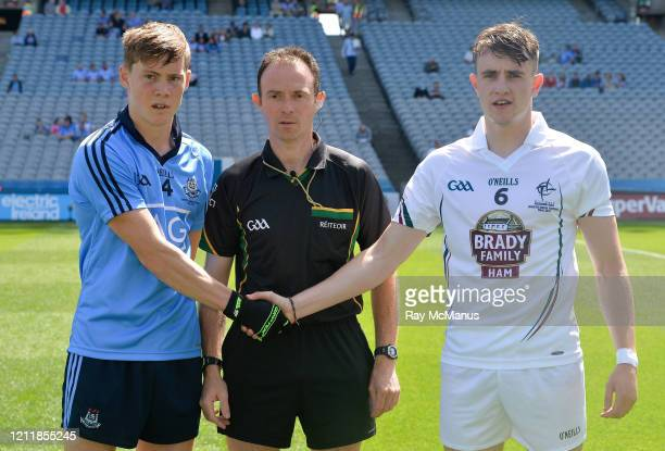 Dublin Ireland 20 July 2014 Dublin captain Con O'Callaghan shakes hands with Kildare captain Paul Mescal before the game with referee John Hickey...