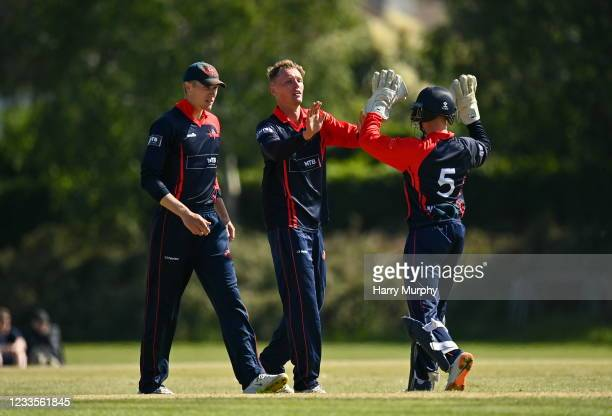 Dublin , Ireland - 20 June 2021; Ben White of Northern Knights, centre, celebrates a wicket with Neil Rock during the Cricket Ireland InterProvincial...