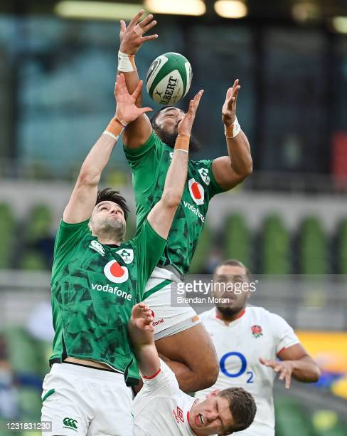 Dublin , Ireland - 20 March 2021; Bundee Aki of Ireland intercepts the ball ahead of team-mate Conor Murray and George Ford of England during the...