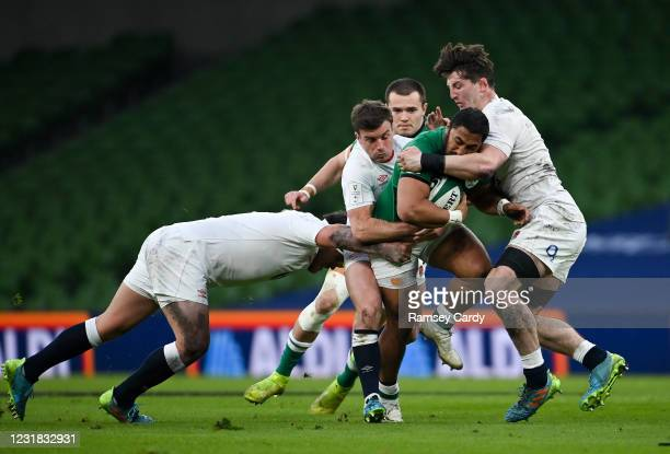 Dublin , Ireland - 20 March 2021; Bundee Aki of Ireland is tackled by Jamie George, left, George Ford, centre, and Tom Curry of England during the...