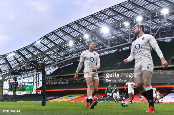 Dublin , Ireland - 20 March 2021; England players Jonny May, left, and Elliot Daly react after Keith Earls scored Ireland's third try, whcch was...