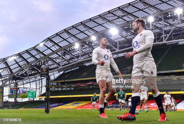 Dublin , Ireland - 20 March 2021; England players Jonny May, left, and Elliot Daly react after Keith Earls scored Ireland's third try, which was...