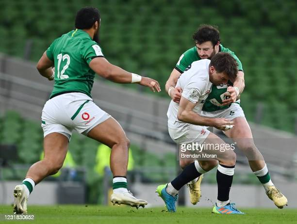 Dublin , Ireland - 20 March 2021; George Ford of England is tackled by Robbie Henshaw of Ireland during the Guinness Six Nations Rugby Championship...