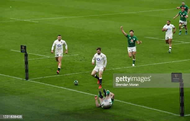 Dublin , Ireland - 20 March 2021; Hugo Keenan, Josh van der Flier and Rob Herring of Ireland celebrate a try by teammate Keith Earls which was...