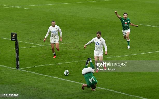 Dublin , Ireland - 20 March 2021; Hugo Keenan of Ireland celebrates a try by teammate Keith Earls which was subsequently disallowed, as Jonny May and...