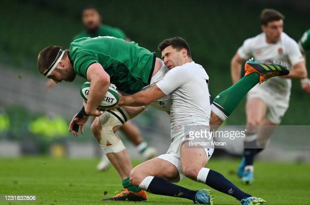 Dublin , Ireland - 20 March 2021; Iain Henderson of Ireland beats the tackle of Ben Youngs of England during the Guinness Six Nations Rugby...