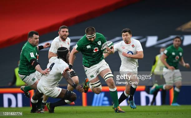 Dublin , Ireland - 20 March 2021; Iain Henderson of Ireland is tackled by Maro Itoje of England during the Guinness Six Nations Rugby Championship...