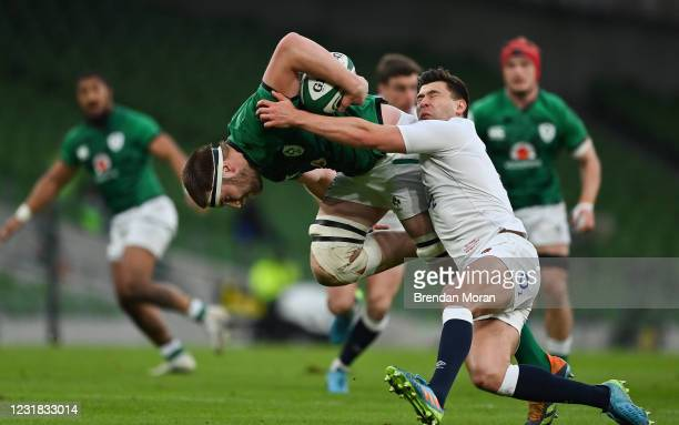 Dublin , Ireland - 20 March 2021; Iain Henderson of Ireland is tackled by Ben Youngs of England during the Guinness Six Nations Rugby Championship...