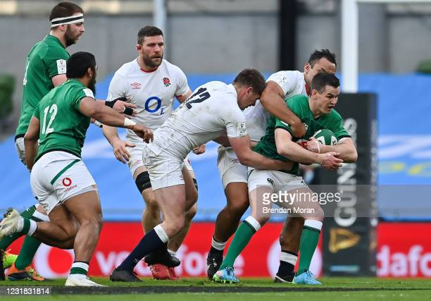 Dublin , Ireland - 20 March 2021; Jonathan Sexton of Ireland is tackled by Owen Farrell and Billy Vunipola of England during the Guinness Six Nations...