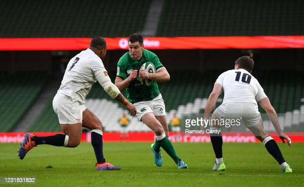Dublin , Ireland - 20 March 2021; Jonathan Sexton of Ireland is tackled by Kyle Sinckler, left, and George Ford of England during the Guinness Six...