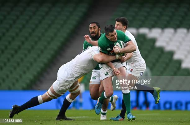 Dublin , Ireland - 20 March 2021; Jonathan Sexton of Ireland is tackled by Charlie Ewels, left, and Ben Youngs of England during the Guinness Six...