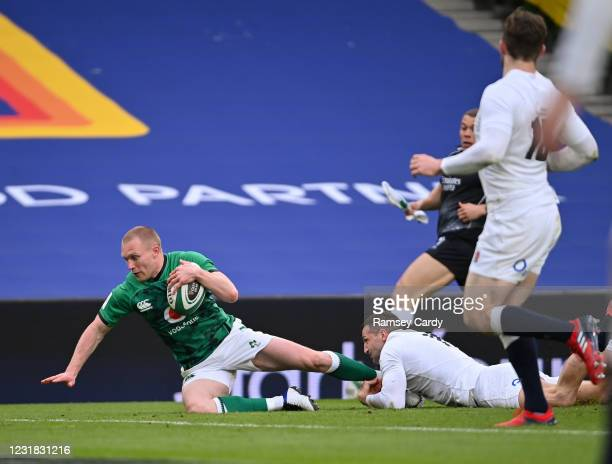Dublin , Ireland - 20 March 2021; Keith Earls of Ireland scores his side's first try despite the tackle of Jonny May of England during the Guinness...