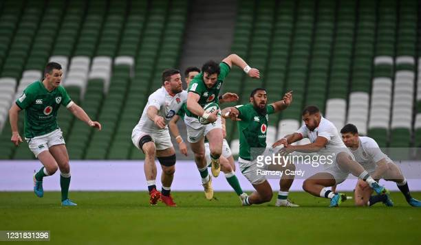 Dublin , Ireland - 20 March 2021; Robbie Henshaw of Ireland is tackled by Billy Vunipola of England during the Guinness Six Nations Rugby...