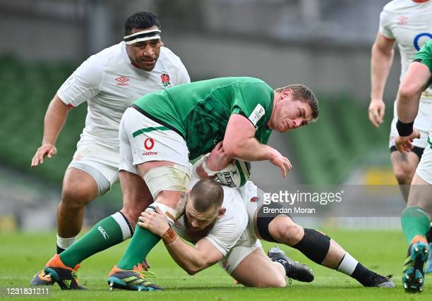 Dublin , Ireland - 20 March 2021; Tadhg Furlong of Ireland is tackled by Luke Cowan-Dickie of England during the Guinness Six Nations Rugby...