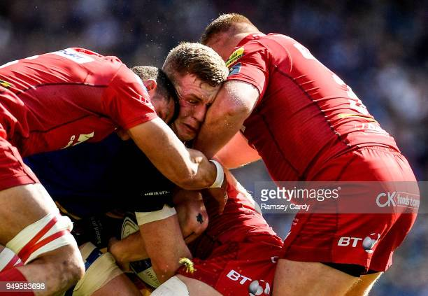 Dublin Ireland 21 April 2018 Dan Leavy of Leinster is tackled by Aaron Shingler left and Samson Lee of Scarlets during the European Rugby Champions...