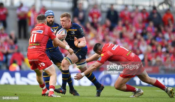 Dublin Ireland 21 April 2018 Dan Leavy of Leinster is tackled by Steff Evans left and Rob Evans of Scarlets during the European Rugby Champions Cup...
