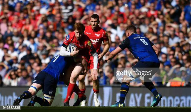 Dublin Ireland 21 April 2018 Rhys Patchell of Scarlets is tackled by Dan Leavy of Leinster during the European Rugby Champions Cup SemiFinal match...