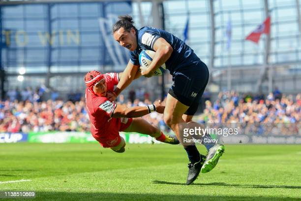 Dublin , Ireland - 21 April 2019; James Lowe of Leinster is tackled by Cheslin Kolbe of Toulouse during the Heineken Champions Cup Semi-Final match...