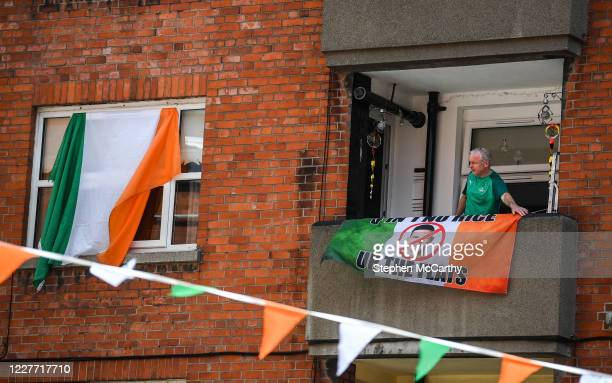 Dublin Ireland 21 July 2020 A Republic of Ireland supporter a resident at The Iveagh Trust Kevin Street in Dublin hangs out a flag during a...