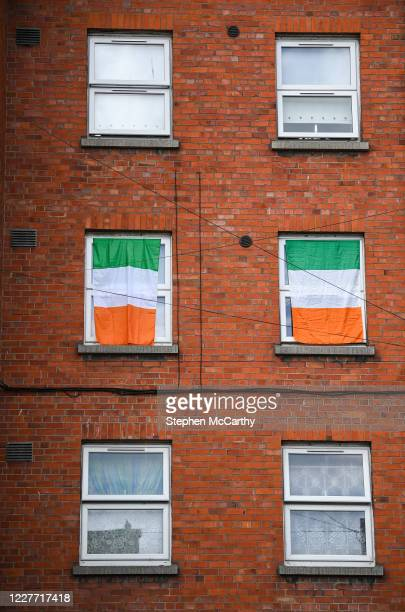 Dublin Ireland 21 July 2020 Republic of Ireland flags hang from windows at The Iveagh Trust Kevin Street in Dublin during a rememberance for Jack...