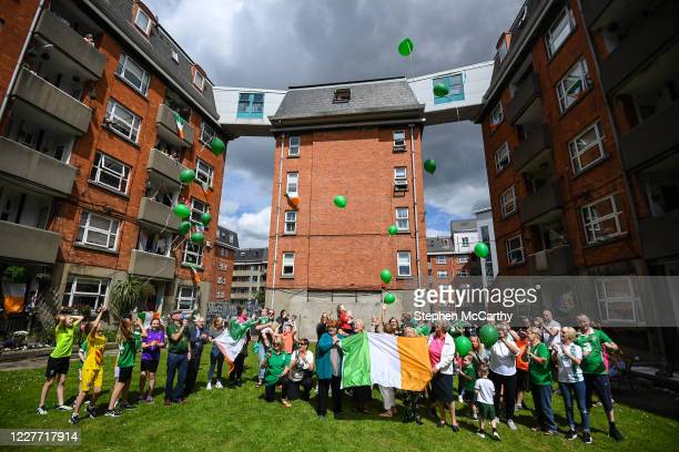 Dublin Ireland 21 July 2020 Residents of Iveagh Trust Kevin Street in Dublin release ballons to remember Jack Charlton on the day of his funeral in...
