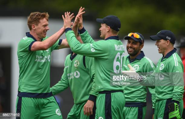 Dublin Ireland 21 May 2017 Barry McCarthy second from left celebrates with teammate Craig Young of Ireland after catching Tom Latham but Young the...