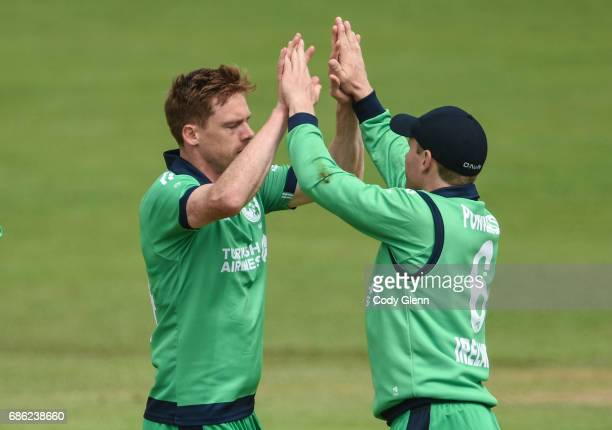 Dublin Ireland 21 May 2017 Craig Young of Ireland left celebrates with teammate William Porterfield after bowling Luke Ronchi of New Zealand during...