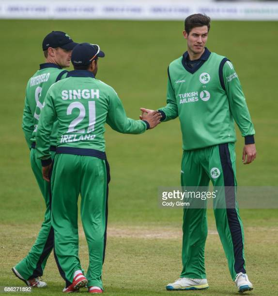 Dublin Ireland 21 May 2017 George Dockrell of Ireland is congratulated by teammates Simi Singh and William Porterfield after stumping Tom Latham of...