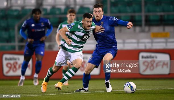 Dublin Ireland 21 September 2020 Aaron Greene of Shamrock Rovers gets away from Waterford's Jake Davidson on his way to scoring his side's first goal...
