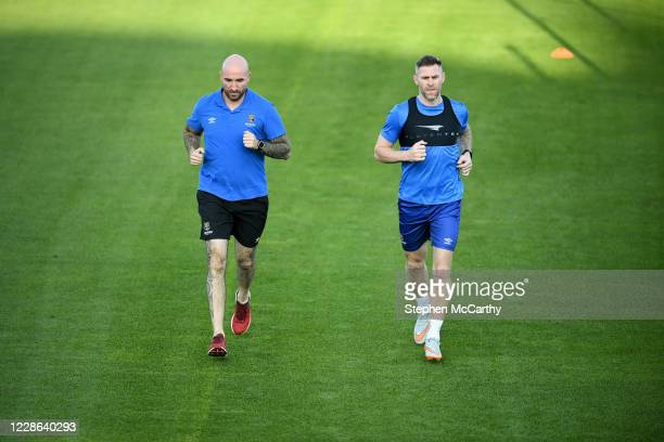 Dublin Ireland 21 September 2020 Daryl Murphy of Waterford goes through some individual running alongside strength conditioning coach Joey O'Brien...