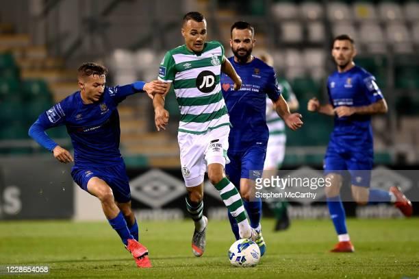 Dublin Ireland 21 September 2020 Graham Burke of Shamrock Rovers in action against Tyreke Wilson left and Kurtis Byrne of Waterford during the SSE...