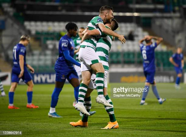 Dublin Ireland 21 September 2020 Jack Byrne is congratulated by his Shamrock Rovers teammate Aaron Greene right after scoring their fourth goal...