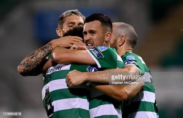 Dublin Ireland 21 September 2020 Roberto Lopes left is congratulated by Shamrock Rovers teammates Lee Grace Aaron Greene and Joey O'Brien right after...