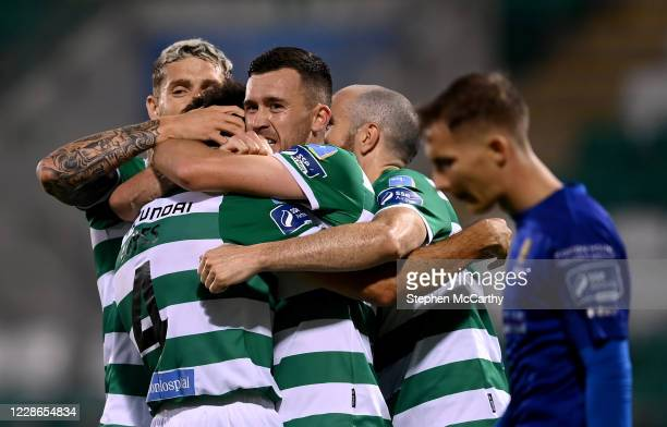 Dublin Ireland 21 September 2020 Roberto Lopes second from left is congratulated by Shamrock Rovers teammates Lee Grace left Aaron Greene and Joey...