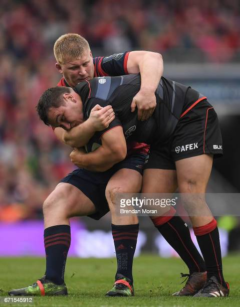 Dublin Ireland 22 April 2017 Jamie George of Saracens is tackled by John Ryan of Munster during the European Rugby Champions Cup SemiFinal match...