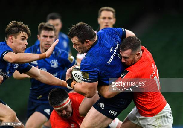 Dublin , Ireland - 22 August 2020; Cian Healy of Leinster is tackled by JJ Hanrahan of Munster during the Guinness PRO14 Round 14 match between...