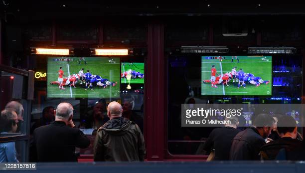 Dublin , Ireland - 22 August 2020; Customers watch a television, while eating or awaiting their meal, showing the Guinness PRO14 Round 14 match...