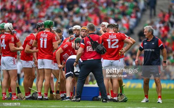 Dublin , Ireland - 22 August 2021; Cork manager Kieran Kingston, right, with his team during the first half water break during the GAA Hurling...