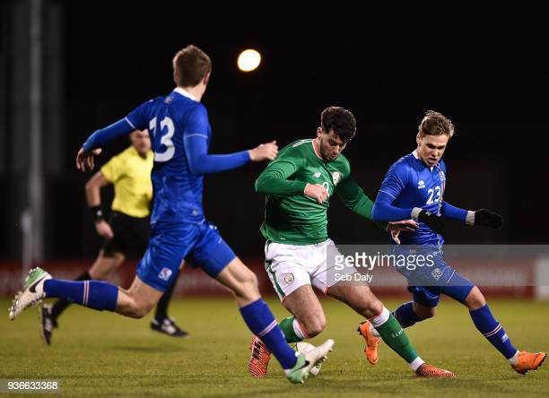 Dublin Ireland 22 March 2018 Joe Quigley of Republic of Ireland in action against Arnor Sigurdsson right and Ari Leifsson of Iceland during the U21...